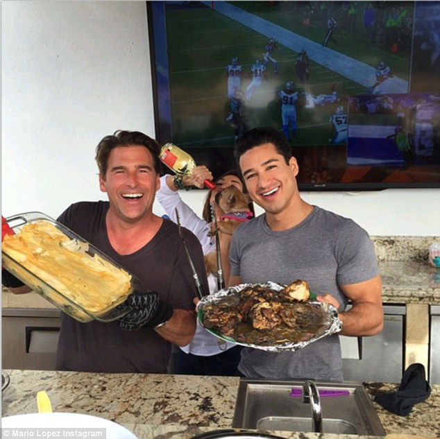 Let's eat! Mario Lopez and a pal cooked up some game day snacks to eat while watching