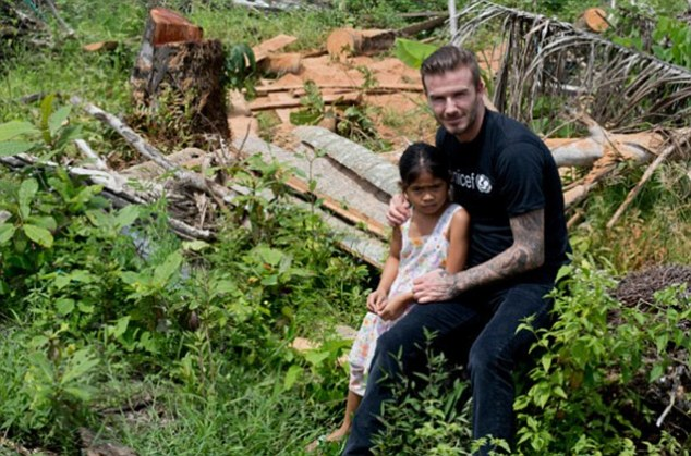 Beckham is pictured in 2013 with Venus, whose sister Viana was swept to her death during the typhoon