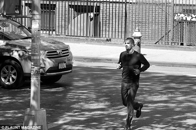 In great shape: Eric can be seen running across the road in one of the brooding black and white shots