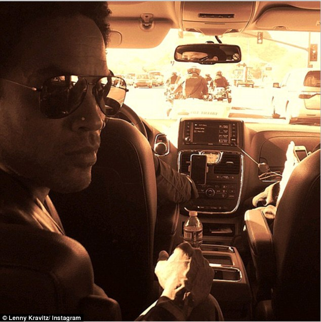 En route with police motorcade! Lenny Kravitz had the best bodyguards protecting him while he approached the stadium: 'The good officers of the Phoenix PD are making sure I'm not late to the #SuperBowl #SB49'