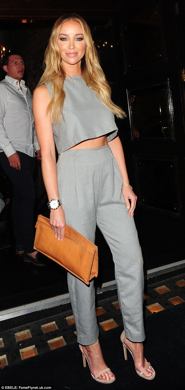 Fifty shades of grey: Lauren Pope lived up to her reputation as a style icon during a night out at celebrity hotspot Cafe De Paris in London on Saturday night
