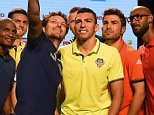 (L-R) French footballer and Delhi Dynamos FC player Florent Malouda, Portuguese footballer and Atletico de Kolkata striker Helder Postiga, Brazilian footballer and Chennaiyin FC player Elano Blumer, Brazilian footballer and FC Goa player Lucio, Romanian footballer and FC Pune City player Adrian Mutu and French footballer and Mumbai City FC coach Nicolas Anelka pose for a mobile phone picture during the media interaction session for the Indian Super League (ISL) football tournament 2015 season in Mumbai on September 26, 2015.  AFP PHOTOSTR/AFP/Getty Images