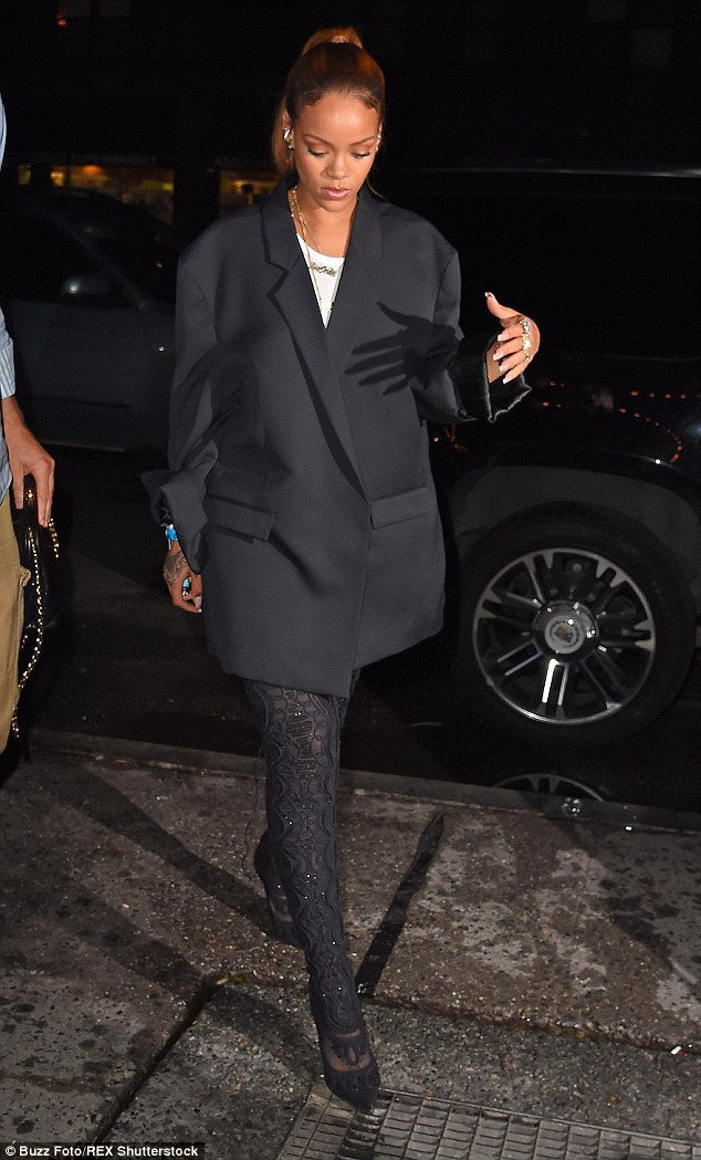 Covered up! Later that night, Rihanna shrouded her famous assets under a large black blazer as she headed towards New York's popular Up & Down nightclub with a group of friends