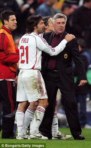 Pirlo chats to Ancelotti during a Champions League quarter-final clash