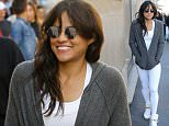 Milan Fashion Week Michelle Rodriguez shopping at Givenchy Milan Ph Claudio Mangiarotti  Pictured: Michelle Rodriguez, Riccardo Tisci Ref: SPL1137068  250915   Picture by: CM / Splash News  Splash News and Pictures Los Angeles: 310-821-2666 New York: 212-619-2666 London: 870-934-2666 photodesk@splashnews.com