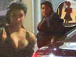 Please contact X17 before any use of these exclusive photos - x17@x17agency.com   Kim Kardashian and daughter dressed up Nori attending Kanye's concert at the Hollywood Bowl friday night sept 25, 2015 X17online.com
