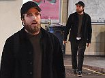 LONDON, ENGLAND - SEPTEMBER 25:  (EXCLUSIVE COVERAGE)(MINIMUM ONLINE/WEB USAGE FEE £150 FOR SET) Robert Pattinson pictured leaving a London underground station after a night out with a friend on September 25, 2015 in London, England.  (Photo by Keith Hewitt/GC Images)