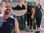 EXCLUSIVE TO INF. \nSeptember 26, 2015: Sweaty and barefoot Gerard Butler stays hydrated after a workout session with his designer girlfriend Morgan Brown in Los Angeles, CA. it is said that couples that workout together stay together.  They were also joined by Pro-volleyball star Gabrielle Reece.\nMandatory Credit: Sasha Lazic/INFphoto.com Ref.: infusla-257