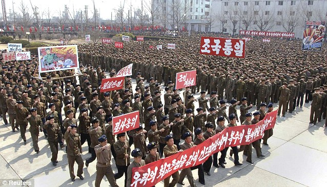 North Koreans gather for a rally to show their support for a potential nuclear war against the United States. This picture was released by North Korea's official news agency and was not verified by a third party