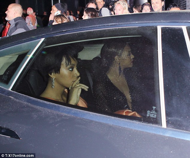 Shocked silence: Beyonce and Solange sat quietly in the backseat as their car pulled away