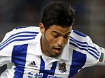 epa04953193 Real Sociedad's Mexican striker Carlos Vela (L) fights for the ball with Laporte (R) of Athletic Bilbaoduring their Primera Division soccer match played at Anoeta stadium in San Sebastian, Basque Country, Spain on 27 September 2015.  EPA/JUAN HERRERO