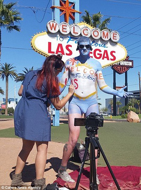 Fletcher works her magic on a subject who is standing in front of the iconic Las Vegas sign which looms in the background