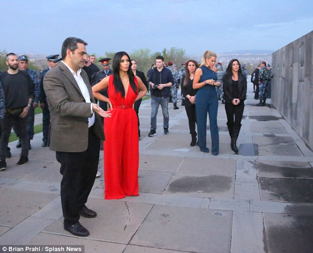 Kim and Khloe walk in the plaza at the Armenian Genocide Memorial. They were accompanied by their cousins Kara and Kourtni and Kim's husband Kanye West. Kim and Khloe's  Armenian heritage comes from their father, the late Robert Kardashian