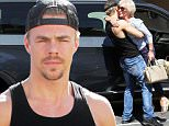 UK CLIENTS MUST CREDIT: AKM-GSI ONLY\nEXCLUSIVE: Hollywood, CA - Derek Hough having fun at the dance studio on Saturday.  He comes out to go to the store on his hover board.  Derek gets a visit from his Grandmother and gives her a huge hug before escorting her in.  As he walks out to meet with fans he shows this rock n roll side.\n\nPictured: Derek Hough\nRef: SPL1137630  260915   EXCLUSIVE\nPicture by: AKM-GSI / Splash News\n\n