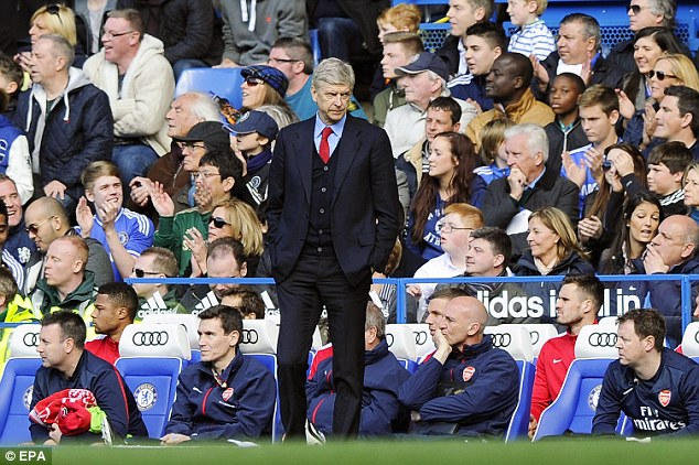 Disaster: Wenger watches on as Arsenal are thumped 6-0 by Chelsea on Sunday