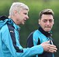 epa04954039 Arsenal manager Arsene Wenger (L) with players Mesut Oeil (C) and Laurent Koscielny (R) during a training session at Arsenal's training complex in London Colney, Hertfordhshire, London, Britain, 28 September 2015. Arsenal plays Olympiacos of Greece in a Champions League group stage match in London on 29 September.  EPA/ANDY RAIN