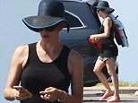UK CLIENTS MUST CREDIT: AKM-GSI ONLY\nEXCLUSIVE: *SHOT ON 9/26/15* Santa Monica, CA - Pretty mama Jennifer Garner decided to make the most out of a beautiful sunny day by taking her kids to the beach in Santa Monica.  Jennifer shielded her eyes from the sun in an oversized floppy hat  and a pair of sunglasses as she helped her nanny unload their trunk. According to recent news reports online, Jennifer is reportedly pregnant with baby number four, which may halt their current separation. Ben was nowhere to be seen as Jennifer helped her children change into beach attire.\n\nPictured: Jennifer Garner\nRef: SPL1138149  270915   EXCLUSIVE\nPicture by: AKM-GSI / Splash News\n\n