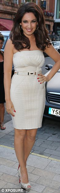 If you've got it, flaunt it: Kelly Brook was keen to show off her shapely rear as she arrived at the Samsung - VIP launch party in Mayfair