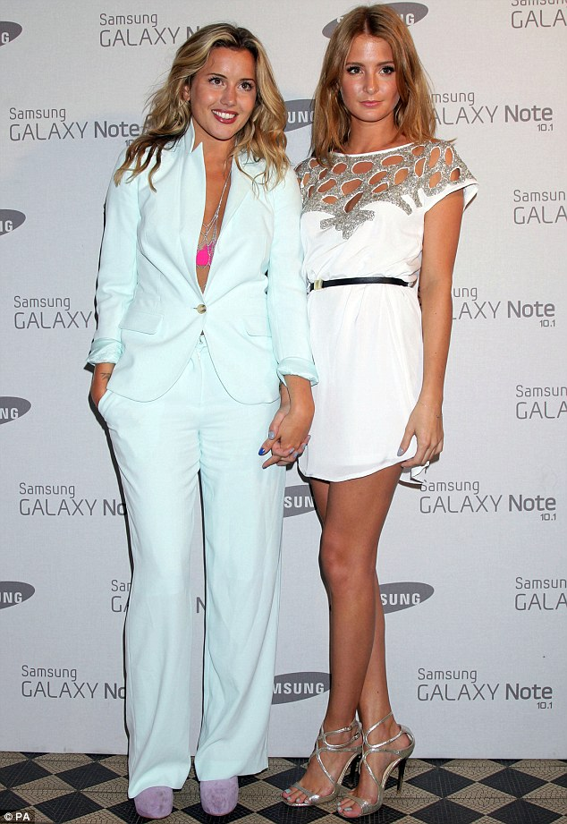 Best pals: Millie's Made In Chelsea co-star and close chum Caggie Dunlop didn't get it quite right in an ill-fitting aqua trouser suit and visible pink bra