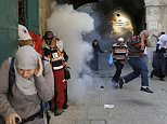 Palestinian protesters run away as Israeli police throw a stun grenade in Jerusalem's Old City September 28, 2015. REUTERS/Ammar Awad        TPX IMAGES OF THE DAY