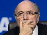 FILES - A picture taken on July 20, 2015 shows FIFA president Sepp Blatter gesturing during a press conference at the football's world body headquarter's in Zurich.  Blatter says payments to Platini were 'valid compensation' according to his lawyer on September 28, 2015.  AFP PHOTO / FABRICE COFFRINIFABRICE COFFRINI/AFP/Getty Images