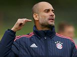 Coach Pep Guardiola of FC Bayern Munich reacts during his team's training session on the eve of their Champions League Group F soccer match against Dinamo Zagreb in Munich, Germany September 28, 2015. REUTERS/Michael Dalder