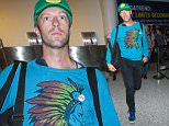 Los Angeles, CA - Chris Martin and his daughter Apple Martin arrive in Los Angeles at LAX. Apple covered up as her father took the lead to smile for the cameras on their way to their ride into town.\n AKM-GSI    September 27, 2015\nTo License These Photos, Please Contact :\nSteve Ginsburg\n(310) 505-8447\n(323) 423-9397\nsteve@akmgsi.com\nsales@akmgsi.com\nor\nMaria Buda\n(917) 242-1505\nmbuda@akmgsi.com\nginsburgspalyinc@gmail.com