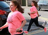 COLEEN THE YARD0227.jpg\nPREGNANT WAG COLEEN ROONEY MAKES A DASH FOR IT AS SHE LEAVES A JUICE SHOP IN ALDERLEY EDGE CHESHIRE, SOWING HER GROWING BABY BUMP IN A WILD THING T SHIRT