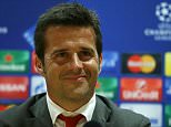 Olympiacos manager Marco Silva smiles during a press conference at the Emirates Stadium, ahead of the Champion's League group stage soccer match against Arsenal, in London, Monday Sept. 28, 2015. (AP Photo/Tim Ireland)