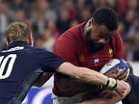 France's centre Mathieu Bastareaud (C) is tackled by Scotland's fly-half Finn Russell (2nd L) and Scotland's prop Gordon Reid (R)  during the rugby union test match between France and Scotland at the Stade de France in Saint-Denis, north of Paris, on August 5, 2015. AFP PHOTO / LOIC VENANCELOIC VENANCE/AFP/Getty Images