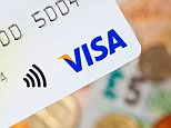 D2D96B Bath, United Kingdom - November 8, 2011: Close-up of a contactless Visa credit card with UK currency in the background
