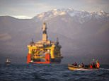 The Olympic Mountains in the background, a small boat crosses in front of an oil drilling rig as it arrives in Port Angeles, America.  aboard a transport ship after traveling across the Pacific. Royal Dutch Shell hopes to use the rig for exploratory drilling during the summer open-water season in the Chukchi Sea off Alaska's northwest coast, if it can get the permits. Royal Dutch Shell cleared a major hurdle Monday, May 11, 2015, when The Bureau of Ocean Energy Management approved Shell's exploration plan. However, this isn't the final step that Shell needs for Arctic drilling. (Daniella Beccaria/seattlepi.com via AP, File) MAGS OUT; NO SALES; SEATTLE TIMES OUT; TV OUT; MANDATORY CREDIT