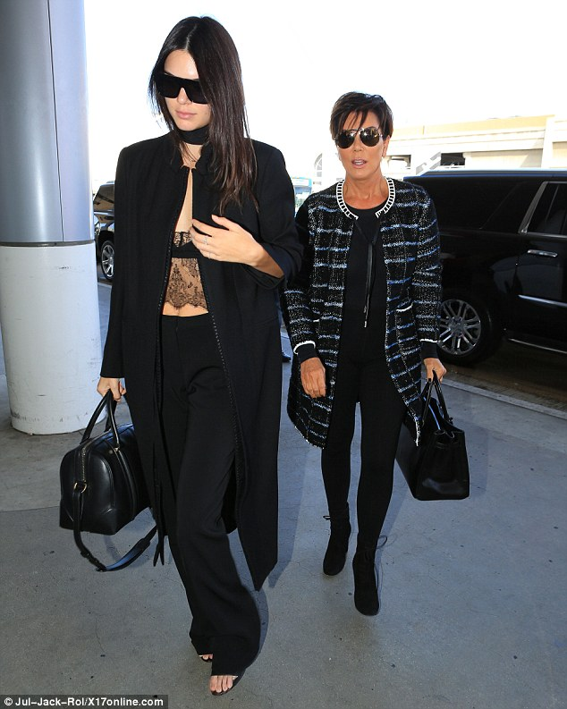 Monochromatic: Kendall coordinated her daring top with a pair of wide-legged trousers in the same color and also carried a black leather handbag