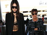 Kris Jenner  and Kendall Jenner in black and white heading to Paris  September 28, 2015 X17online.com