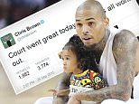 Chris Brown with daughter Royalty  at basketball game /X17online.com