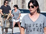 EXCLUSIVE TO INF. \nSeptember 27th, 2015: Sporting a 'Super Loved' print t-shirt, Shannon Doherty and husband Kurt Iswarienko grab groceries in preparation for Sunday night dinner in Malibu, CA.\nMandatory Credit:  SAA/Borisio/Lazic\nRef:infusla-301/277/257