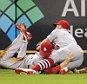 Sep 28, 2015; Pittsburgh, PA, USA; St. Louis Cardinals left fielder Stephen Piscotty (left) and center fielder Peter Bourjos (8) collide making a catch on a ball hit by Pittsburgh Pirates third baseman Josh Harrison (not pictured) during the seventh inning at PNC Park. Piscotty  was taken from the game on a stretcher. Mandatory Credit: Charles LeClaire-USA TODAY Sports