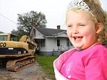 """EXCLUSIVE: **PREMIUM EXCLUSIVE RATES APPLY**Mystery surrounded the fate of reality TV star Honey Boo Boo's old family home in rural Georgia, as diggers moved in on Monday morning (sept 28). Workers were seen ripping down a small, dilapidated former library that sits right next to one of reality TV's most famous houses, where the 'Here Comes Honey Boo Boo' clan filmed four seasons of their hit TLC show before it was sensationally axed amid a child abuse scandal. But it wasn't yet clear whether the family house itself, in the tiny town of McIntyre, would also be demolished. Alana's father Mike 'Sugar Bear' Thompson was seen at the three-bed property, which was recently listed for $45k. June 'Mama June' Shannon moved the family to Hampton, Georgia, when the show ended earlier this year but Sugar Bear still lives close by. Mama June said she was under the impression the house would be torn down, adding: """"There are a lot of great memories for the whole family from our time at that house."""""""