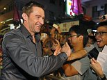 Australian actor Hugh Jackman shakes hands with his fans during an event to celebrate the Chinese Mid-Autumn Festival in Hong Kong, Monday, Sept. 28, 2015. Like ancient Chinese poets, Hong Kong people appreciate the beauty of the full moon in the Mid-Autumn Festival. (AP Photo/Kin Cheung)