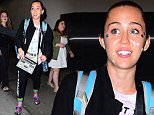 EXCLUSIVE: Miley Cyrus was spotted arriving to NYC for her appearance on the Season Premiere of SNL. She took photos with fans, sticking out her tongue , and throwing up the middle finger. One fan took a photo while riding a Self-Balancing Board. She looks casual in a black hoodie, and wore a pair of Custom Patricia Fields Crocs as she made her way out of the airport.\n\nPictured: Miley Cyrus\nRef: SPL1137287  270915   EXCLUSIVE\nPicture by: 247PAPS.TV / Splash News\n\nSplash News and Pictures\nLos Angeles: 310-821-2666\nNew York: 212-619-2666\nLondon: 870-934-2666\nphotodesk@splashnews.com\n