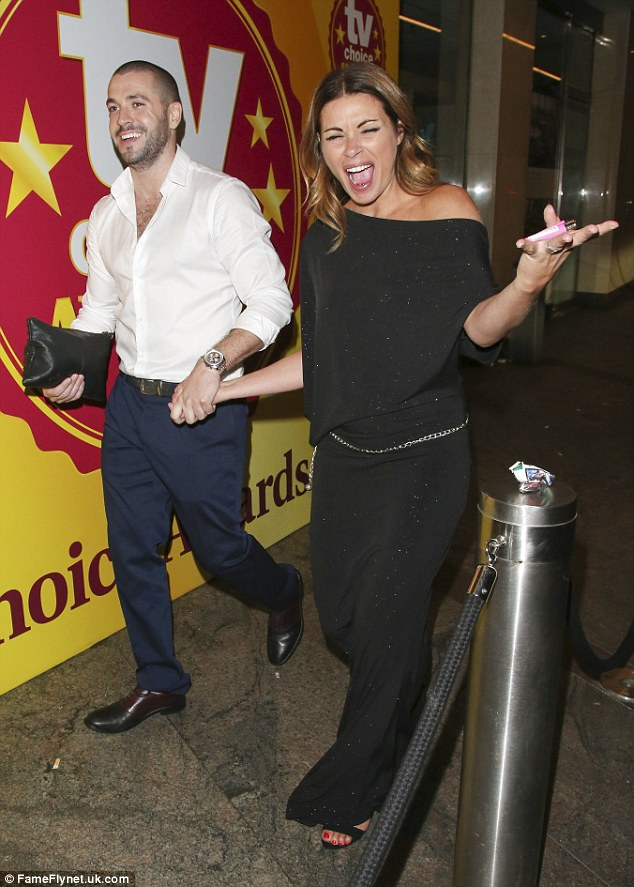 Wild night; She was held by the hand as Shayne Ward helped her to exit
