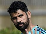 Chelsea's Brazilian-born Spanish striker Diego Costa waves as he arrives for a training session at Chelsea's training ground in Stoke D'Abernon, south of London, on September 28, 2015, on the eve of their UEFA Champions League Group G football match against Porto.   AFP PHOTO / FRANCK FIFEFRANCK FIFE/AFP/Getty Images