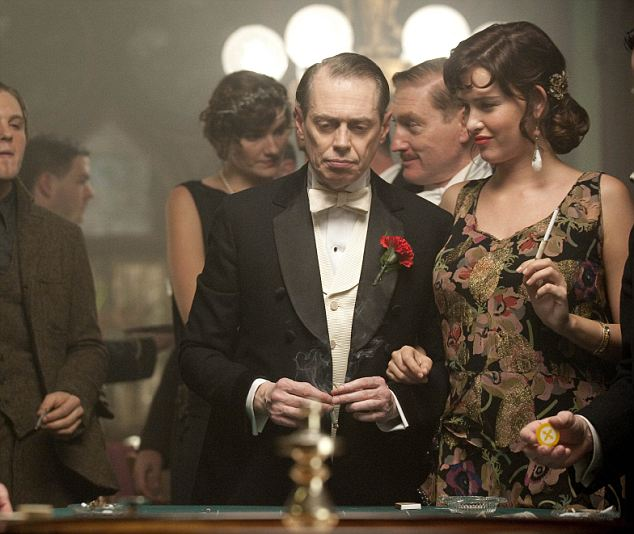 Steve Buscemi (who plays Steve 'Nucky' Thompson) and Paz de la Huerta (Lucy Danziger) frequent a casino in a scene from Boardwalk Empire. Atlantic City hotels are now offering tours which tie in themes from the show