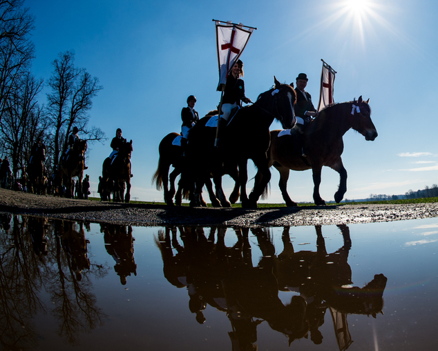 Riders take part in a Easter procession near Zerkwitz, eastern Germany Easter Sunday April 5, 2015. (AP Photo/dpa, Patrick Pleul)