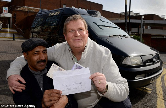 Reward: Taxi driver Mohammed Nisar (left) accepts a reward from sole trader Adrian Quinn after returning a bag the passenger left in his taxi containing £10,000 in cash
