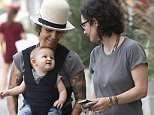 """Picture Shows: Linda Perry, Rhodes Gilbert Perry, Sara Gilbert  September 27, 2015    Couple, Sara Gilbert and Linda Perry take their son, Rhodes Gilbert Perry grocery shopping in Los Angeles, California.     Sara and her wife, Linda Perry, have just released their new children album """"Deer Sounds"""". 'ET' said they were inspired by their 6-month-old son which helped fuel the songs.     Exclusive - All Round  UK RIGHTS ONLY    Pictures by : FameFlynet UK © 2015  Tel : +44 (0)20 3551 5049  Email : info@fameflynet.uk.com"""