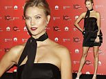 US supermodel Karlie Kloss poses on the occasion of a party to celebrate Vogue China 10th anniversary, in downtown Milan, Italy, Monday, Sept. 28, 2015. (AP Photo/Antonio Calanni)
