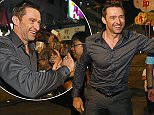 Australian actor Hugh Jackman reaches out to his fans during an event to celebrate the Chinese Mid-Autumn Festival in Hong Kong, Monday, Sept. 28, 2015. Like ancient Chinese poets, Hong Kong people appreciate the beauty of the full moon in the Mid-Autumn Festival. (AP Photo/Kin Cheung)