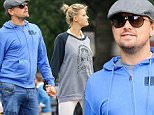 EXCLUSIVE: Leonardo DiCaprio and Kelly Rohrbach are spotted hand-in-hand while taking a romantic stroll in Midtown, New York City\n\nPictured: Leonardo DiCaprio and Kelly Rohrbach\nRef: SPL1138074  270915   EXCLUSIVE\nPicture by: Felipe Ramales / Splash News\n\nSplash News and Pictures\nLos Angeles: 310-821-2666\nNew York: 212-619-2666\nLondon: 870-934-2666\nphotodesk@splashnews.com\n