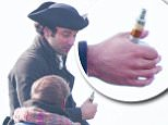 Aidan Turner films Poldark, Cornwall, UK. He is seen with his vaporizer cigarette whilst chatting to a friend. \n\nPictured: Aidan Turner\nRef: SPL1138658  290915  \nPicture by: MK / Splash News\n\nSplash News and Pictures\nLos Angeles: 310-821-2666\nNew York: 212-619-2666\nLondon: 870-934-2666\nphotodesk@splashnews.com\n